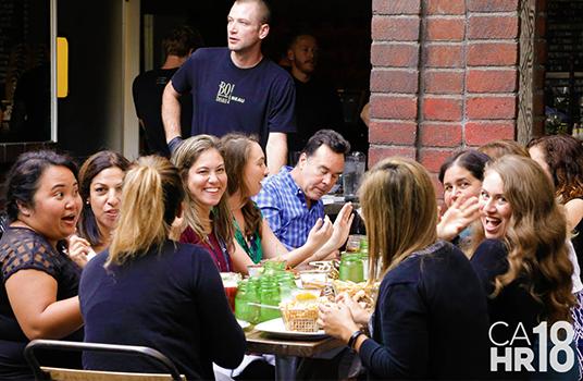 HR professionals smiling & dining together
